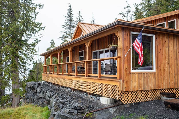 Picture of the Anglers Lodge showing the ocean view deck overlooking clover pass in Ketchikan, Alaska