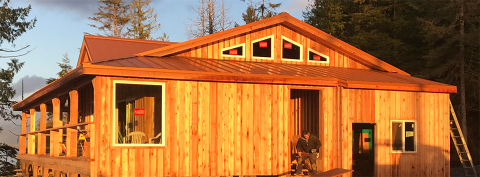 Anglers Lodge Cedar Siding Complete with All New Windows Installed in the Sunrise